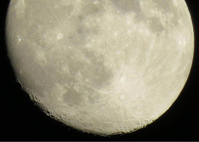 close up near full moon showing details on surface.JPG