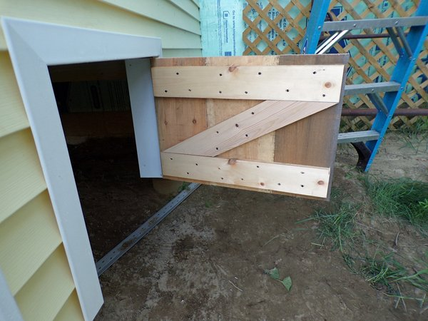 Construction  porch understorage door1 crop July 2020.jpg