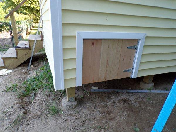 Construction  porch understorage door2 crop July 2020.jpg