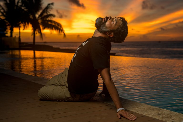 Bearded Middle Age Man, Facing Rejection and Too Little Sleep, at Infinity Pool