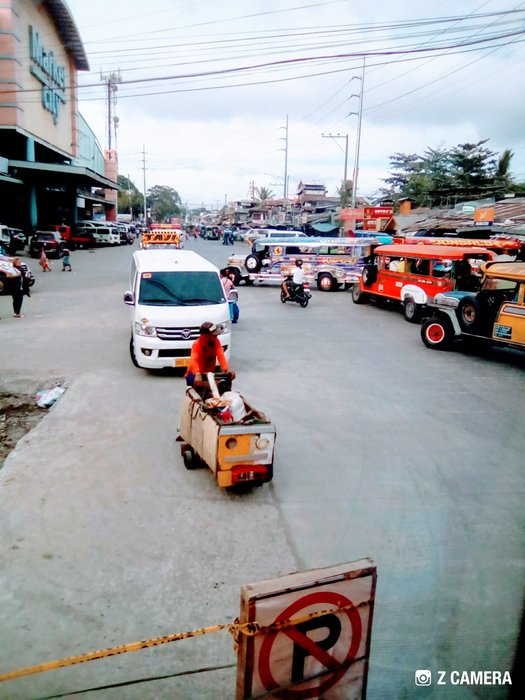 Reaching the Cagayan De Oro City public market from a very long distance rides from the airport. I met the second stranger who shared with me the taxi bill. I was too lucky in my trip. This was the place I found the bus terminal bound for Valencia Bukidnon.
