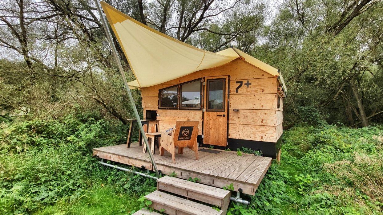 """""""Destinature Camp"""": Tiny houses made of wood."""