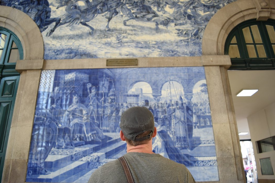 Appreciating the murals at São Bento railway station