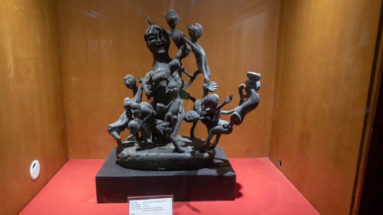 The statue of Men Brayut or Madam Brayut, a Balinese lady who had many children (in Karangasem Building).