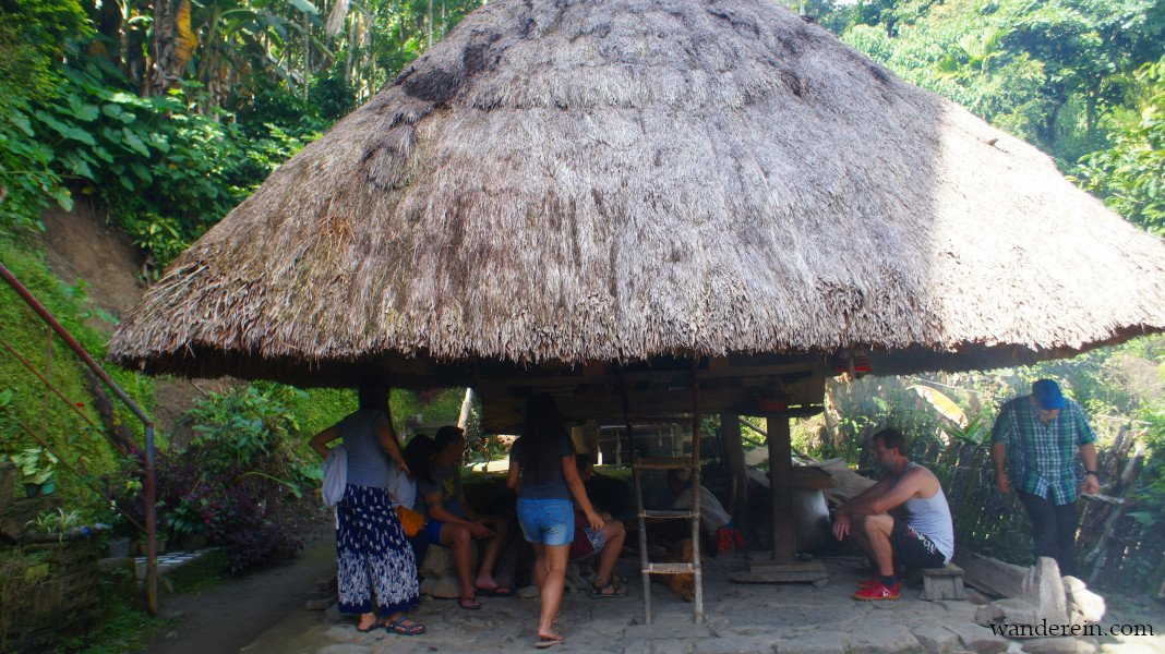 Guests at Mang Ramon's Homestay watch the rice wine preparation