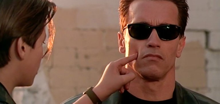 John Connor touching his protector's face (from TERMINATOR 2)