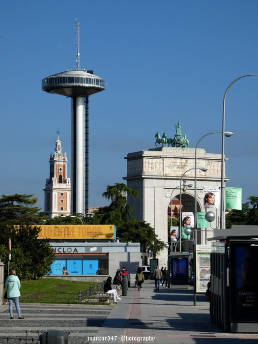 Moncloa: the Lighthouse rising above the Arch of Victory (Puerta de Moncloa)