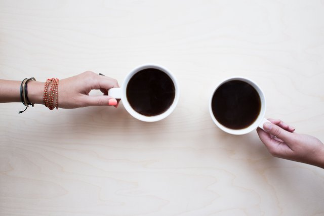 person-holding-white-ceramic-mug-with-black-liquid-272887.jpg