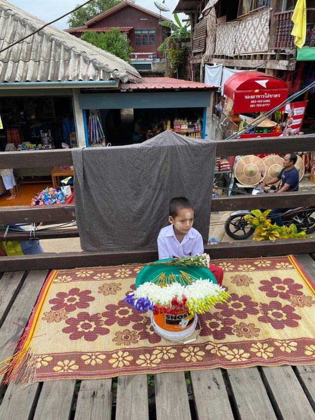 Mon's tribe boy is selling flowers