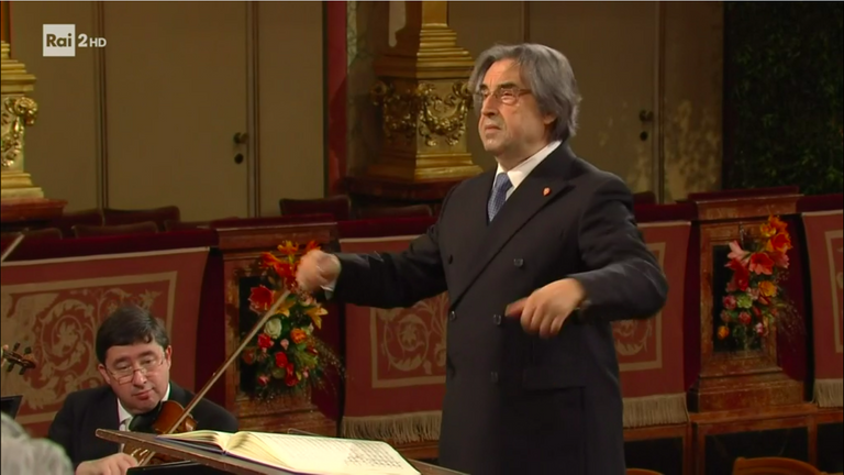 Not even the very Italian conductor is masked...