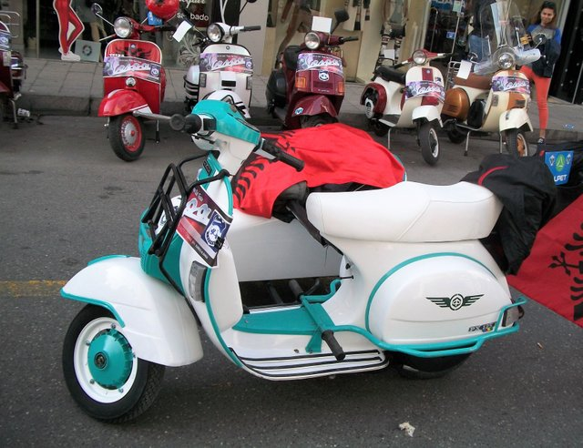 a clean PX125 with matching sidecar
