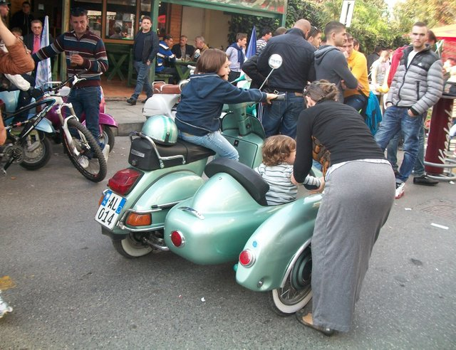 Mom letting the kids try out the sidecar