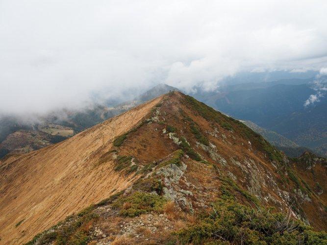 Narrow trail on the mountain ridge