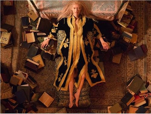 Eve, played by TildaSwinton, packs books for the trip