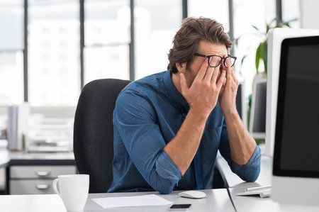 58217498-portrait-of-an-upset-businessman-at-desk-in-office-businessman-being-depressed-by-working-in-office-.jpg