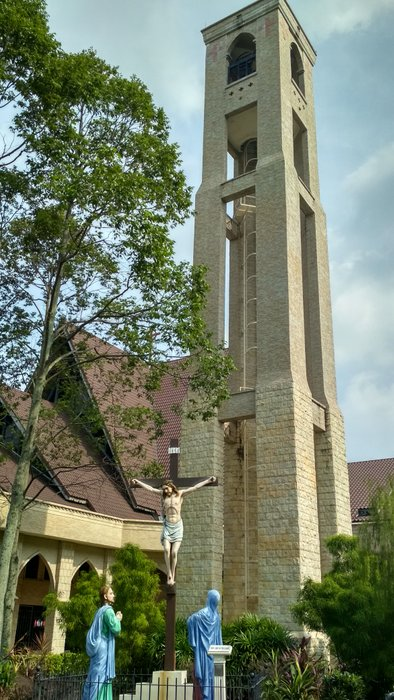 The bell tower and the crucifix at the front