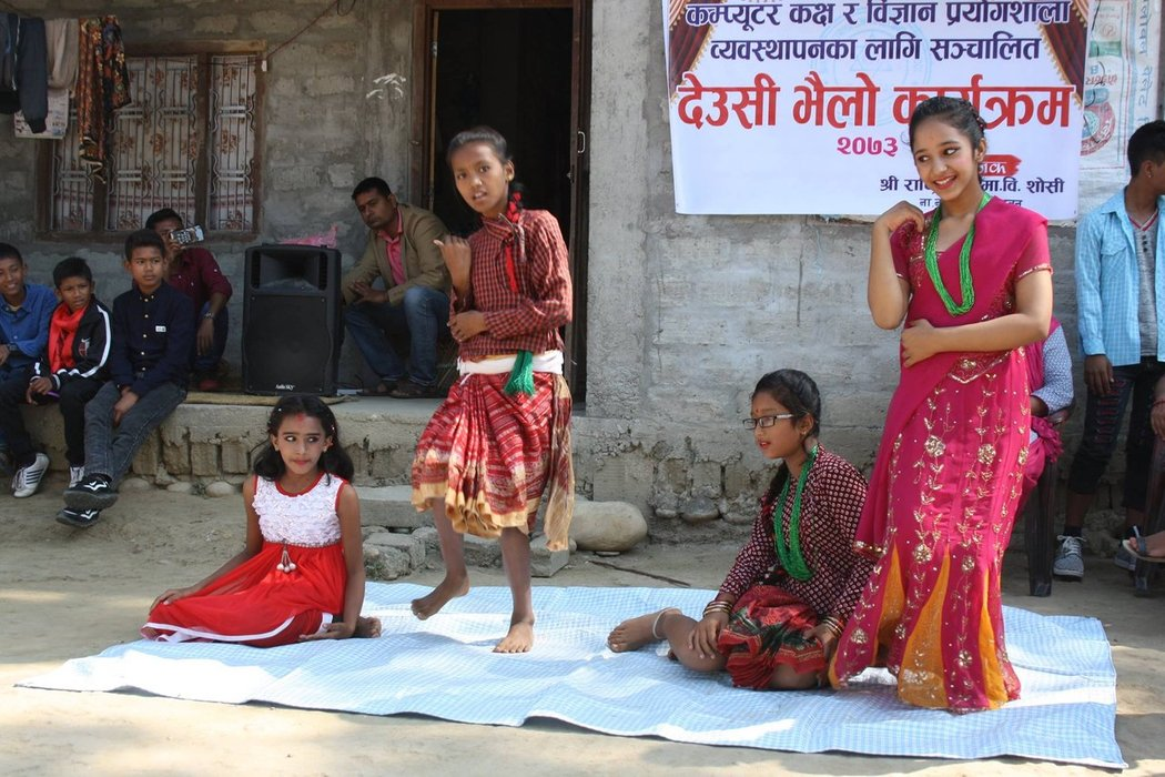 This girl on the right side is Akriti - Tara's daughter. Isn't she beautiful? They were performing to collect some donations for the construction of a new library.