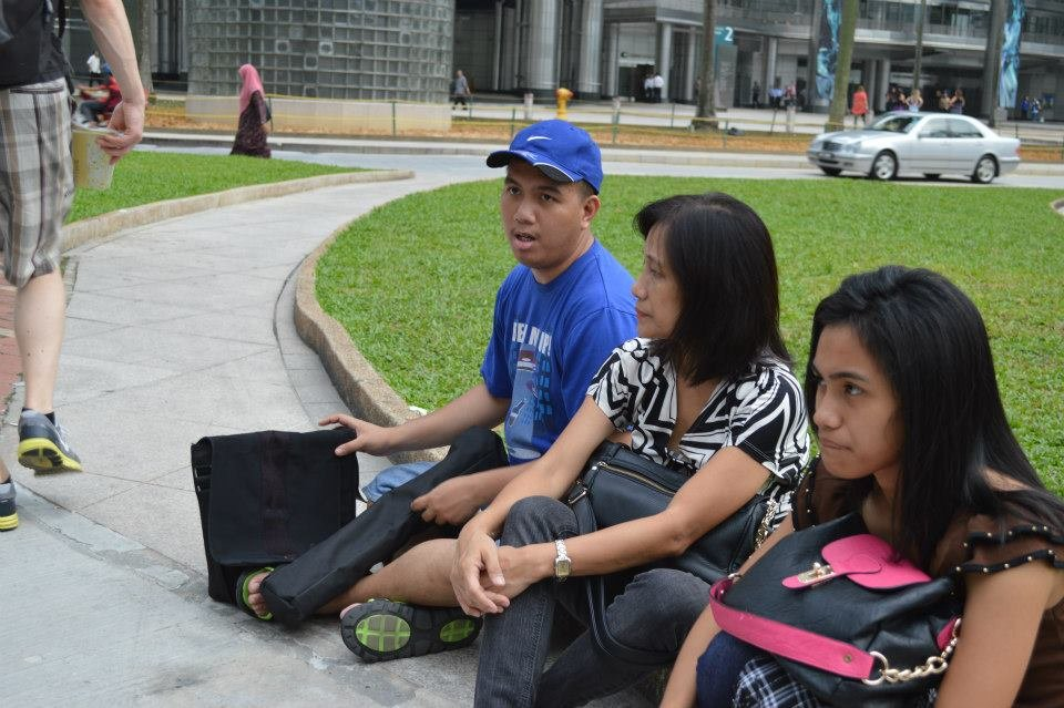 Me, my mom, and Kookee sitting somewhere in Kuala Lumpur, taking a break from a long walk