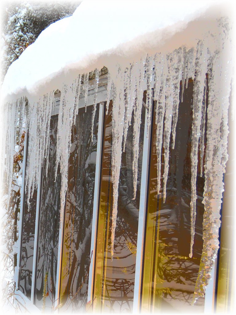close up section of icicles on sun room.JPG
