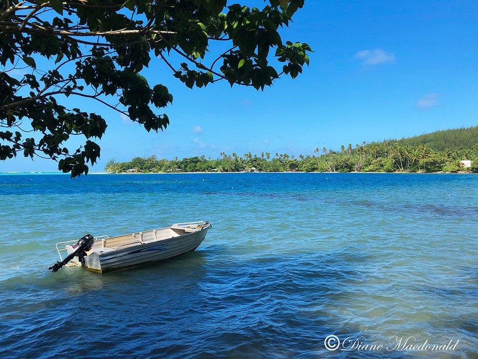 boat in lagoon parea huahine.jpg