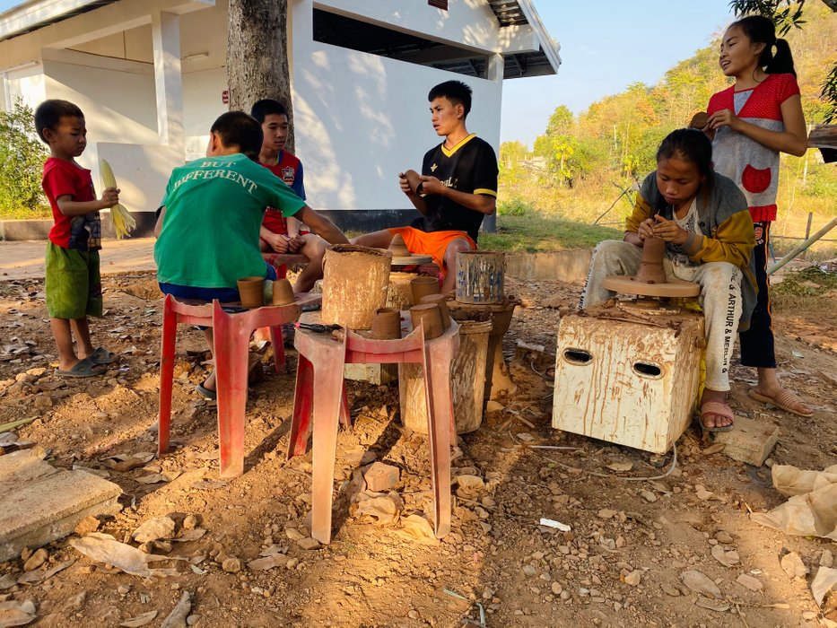 Local children and teenagers making pottery. Unfortunately, we couldn't ask them if they lived there, worked there or if they were just there for a pottery class.