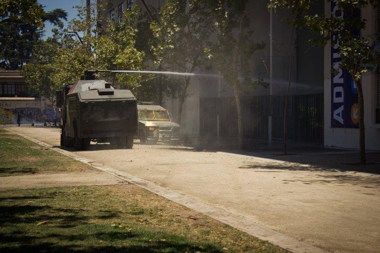 Students clash with carabineros in Santiago 09