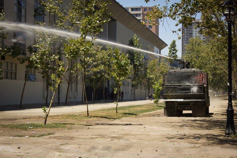 Students clash with carabineros in Santiago 07