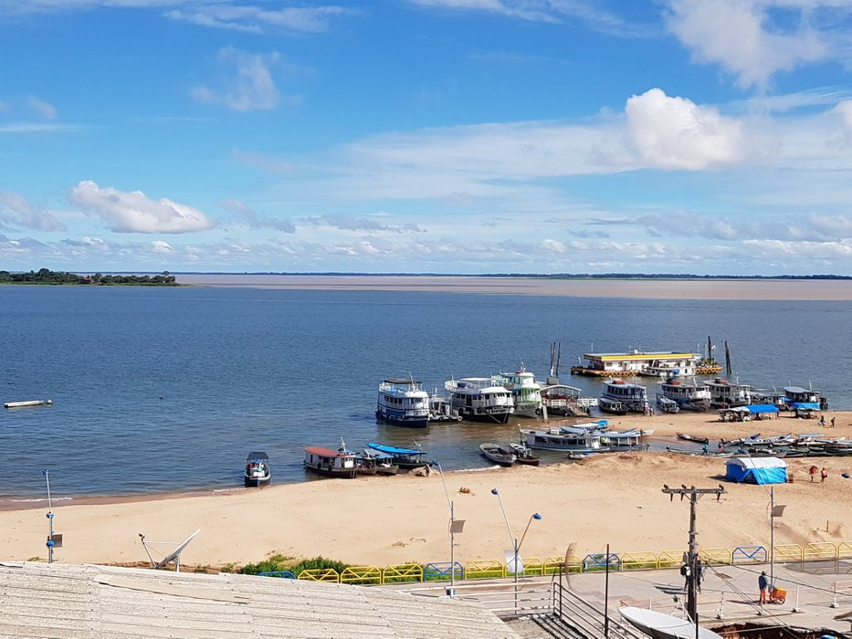 """""""Meeting of the waters"""": The blue Rio Tapajos ends into the brownish Amazon River"""