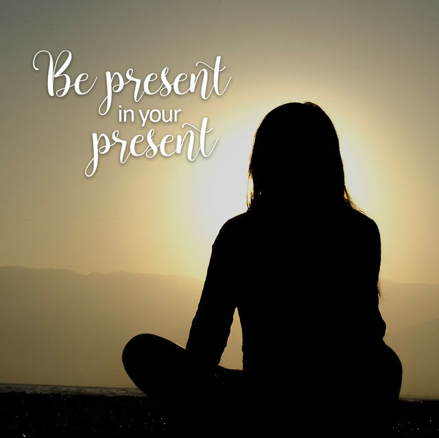 be present in your present siloquette woman sitting looking at sunset.jpg