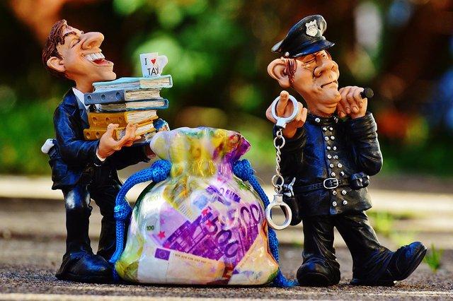 taxestaxevasionpolicehandcuffs.jpg